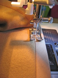 Stitch in the Ditch (on the Previous Stitch Line) on the Right Side of Fabric and Bias Binding