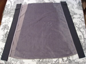 Attach Stretch Knit Panels to Front and Back Pieces of Skirt and Sew Together