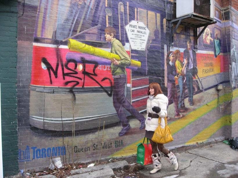 Me, walkng alongside Queen W mural