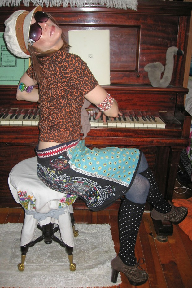 Playing Piano in Bowie Skirt