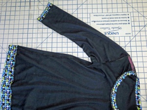 Garment Inside:  overlocked seams and ribbon stay tape added to shoulder seams.