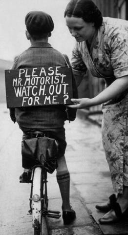Mom Putting sign on her childs bike