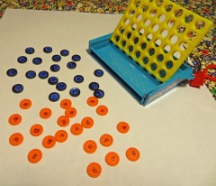 First, Numbers 1 to 44 (the number of entrants) were written on the teeny tiny Connect Four pieces.
